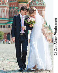 Young wedding couple walking