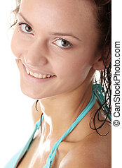 Young wet woman in blue bikini