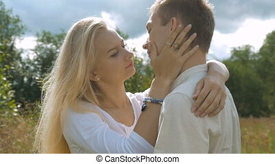 Young white couple on date. The girl gently caresses her...