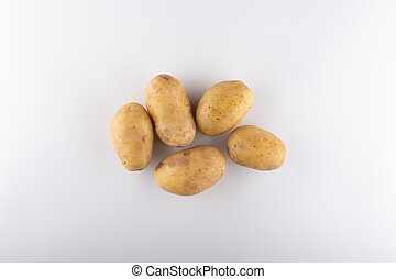 young white potatoes close-up on a white background
