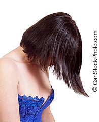 Young white woman in blue corset hair over face
