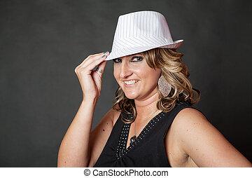 Young white woman wearing white pinstripe hat