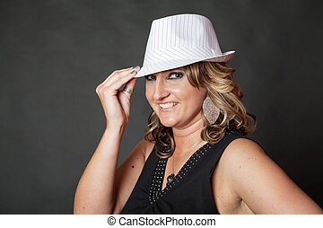 Young white woman wearing white pinstripe hat