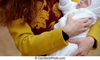 Young white woman with a newborn baby on her hands