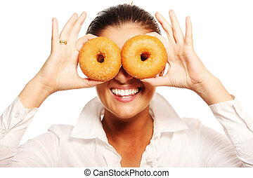 Young wife playing with donuts - A funny picture of a young...