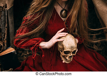 Young witch in the autumn forest - Young woman in red dress ...