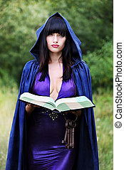 young witch with a book