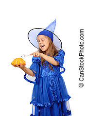 Young witch with a magic wand and pumpkin isolated on the white