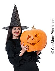 Young witch with halloween gourd isolated on white...