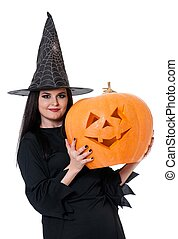 Young witch with halloween gourd over white background