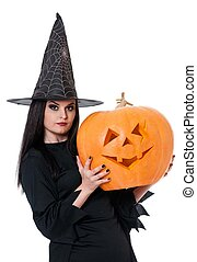 Young witch - Young beautiful witch with halloween gourd...