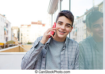 young with mobile phone outdoors