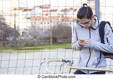 young with outdoor mobile phone