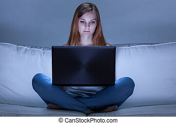 Young woman addicted to computer