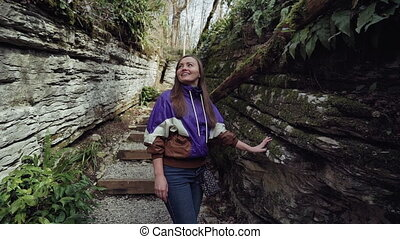 Young woman admires the rock formation HD