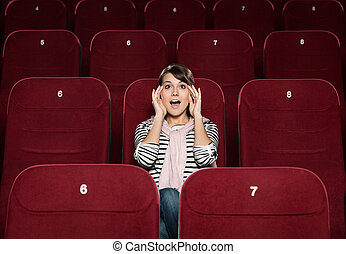 Young woman afraid of the movie