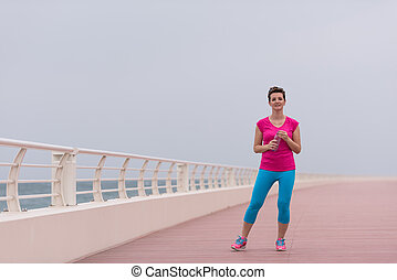 young woman after a successful training run