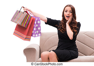 Young woman after christmas shopping on white