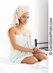 Young woman after  shower in towel