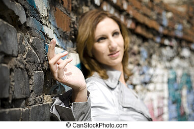 Woman Against A Brick Wall