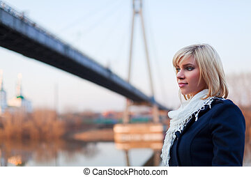 Young woman against a bridge