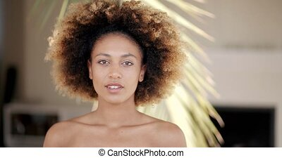 Young Woman Against Palm Tree Branch
