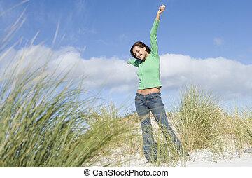 Young woman amongst dunes