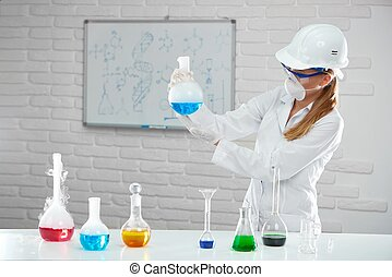 Young woman analyses chemical liquids in the tubes.