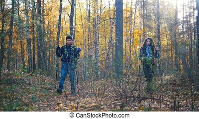 Young woman and a boy on hiking. Scandinavian walk in the...