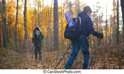 Young woman and a boy on hiking. Scandinavian walk. View...
