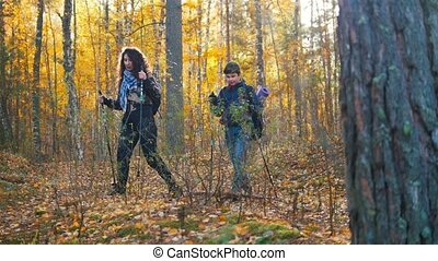 Young woman and a boy on hiking together. Scandinavian walk...