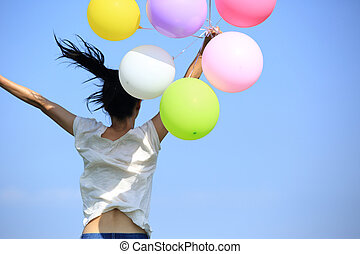young woman and balloons