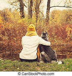 Young Woman and Husky Dog in the Autumn Park Outdoors