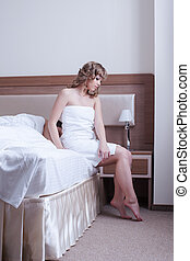 Young woman and man in bedroom