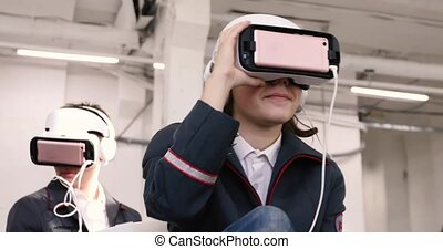 Young woman and man in VR-headset indoores