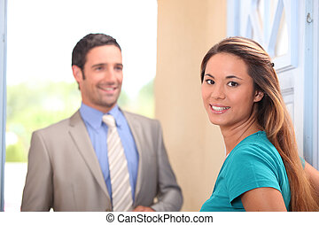 Young woman and real estate promoter