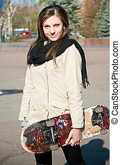 Young woman and skate board