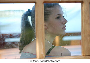 young woman and window - profile of young beautiful woman ...