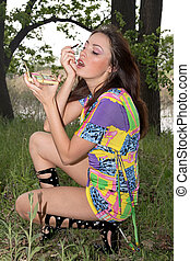 Young woman applying make up outdoors