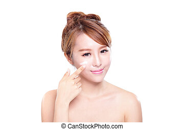 Portrait of young woman applying moisturizer cream on her pretty face isolated on white background, asian beauty