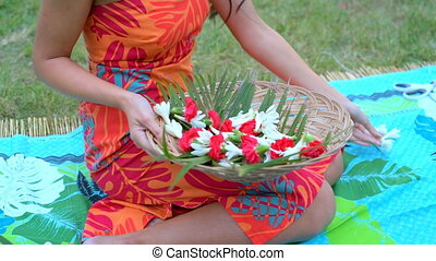 Young woman arranging flower on mat in the garden 4k -...
