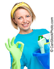 Young woman as a cleaning maid holding bucket full of...