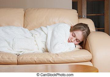 young woman asleep on sofa