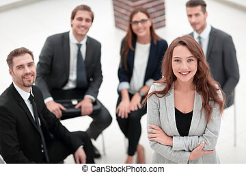 young woman at a business meeting with colleagues.