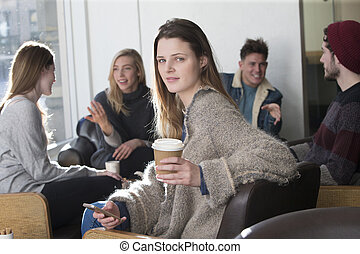 Young woman at a cafe with her friends