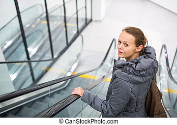 Young woman at a modern shopping center