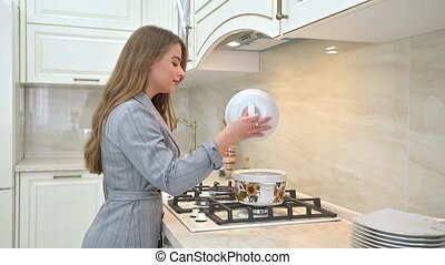 Young woman at beige kitchen designed in provence style