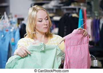 Young woman at clothes shopping store