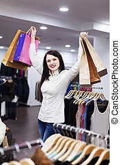 Young woman at clothing store