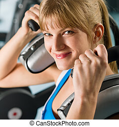 Young woman at gym exercise fitness